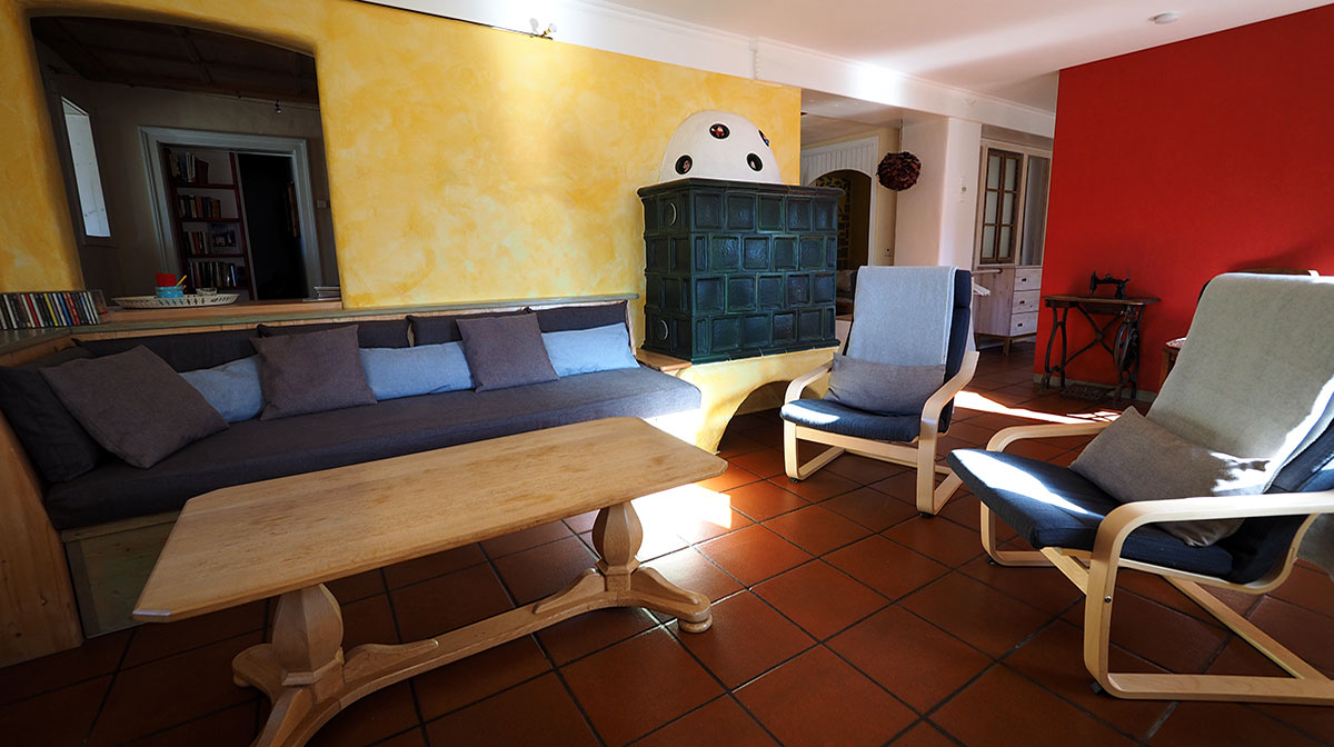 Holiday apartment in the nature and herbal village with tiled stove and cosy sitting area.